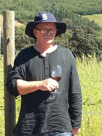 Winemaker Philip Costandius savours a glass of Grenache Noir 2014